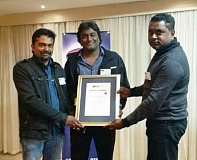 (From left) Brothers Dino and Dersan Pillay from Cordoba Motors receive the Five Star grading award from Vishal Premlall, MIWA Director.