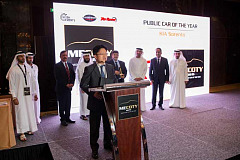 Mr. Alex Chung, President of KIA Motors Middle East and Africa Regional Headquarters, accepts the 2015 MECOTY Public Car of the Year award.