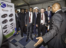 Showing the way: an exhibitor at the first ever Volkswagen Black-Owned Supplier's Day in Uitenhage. Minister Hon. Rob Davies is flanked by Thomas Schaefer, Chairman and MD of Volkswagen Group South Africa (in blue suit) and Eastern Cape MEC for Economic Development the Hon. Saki Somyo look on.