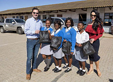 Thomas Schaefer, Chairman and MD of VW Group SA and his wife, Wendy with pupils of Nkululeko Secondary School in KwaNobuhle, Uitenhage