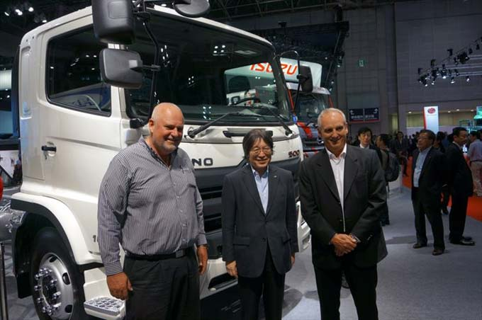 Seen on the Hino stand at the Tokyo Motor Show are (from left): Leslie Long, Hino SA Senior Manager - Marketing, Demand and Product Planning; Koichi Ojima, Executive Vice President of Hino Motors Limited, and Ernie Trautmann, Hino SA Vice President.