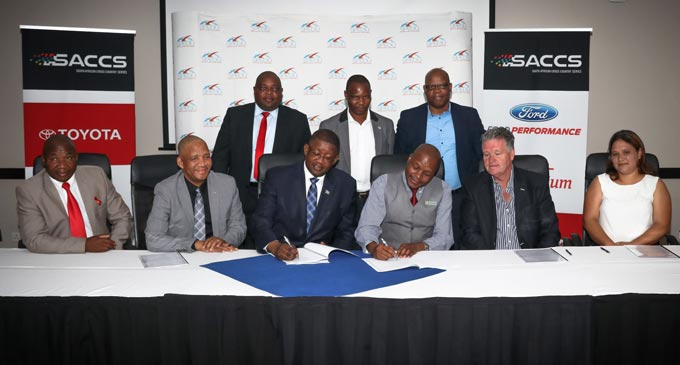 Signing of the memorandum of agreement - Left to right:  Hon. Molosiwa Molosiwa – Major Selebi Phikwe; Ronald Yane – Chairperson SPEDU Board of Directors; Dr. Mokubung Mokobung – CEO SPEDU; Godimo Garegope – Town Clerk Selebi Phikwe; Greg Higgins – Event Director SACCS; Jackie Meyer – Secretary General BMS. Standing Left to right: Jazanga Vezesa – Director Strategic Projects – SPEDU; Patson Dibotelo – Deputy District Commissioner; James Mathokgwane – Director Community Economic Facilitation – SPEDU  Image: Nadia Jordaan