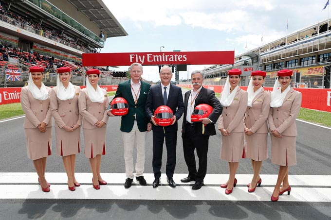 From left to right: Sean Bratches, Managing Director, Commercial Operations at Formula 1, Thierry Antinori, Emirates Executive Vice President and Chief Commercial Officer, and Chase Carey, Chief Executive Officer of the Formula One Group, flanked by Emirates Cabin Crew, before the start of today's Spanish Grand Prix, of which Emirates is the Title Sponsor. Emirates and Formula 1® announced a five year renewal of their Global Partnership.