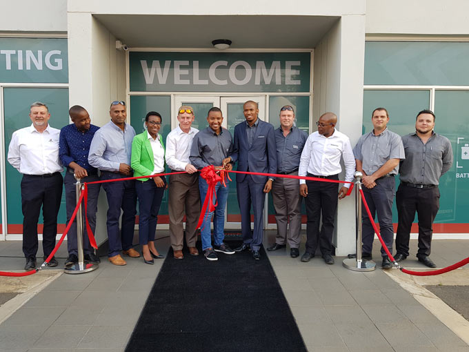 01 - Khaya Ndondo and Silimela (6th from left) and Silimela Lallie (in suit) during the official opening of their fitment centre in Centurion