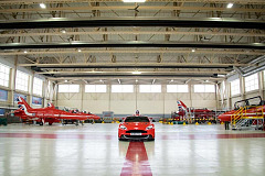 Aston Martin Vanquish s red10 flying on to 'built in britain' feature at the confused.com London motor show