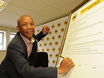 AA CEO Collins Khumalo signing the AA Service Charter