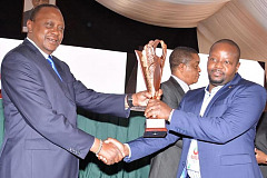 President of the Republic of Kenya, Uhuru Kenyatta, presenting the award for exemplary tax compliance for 2018 to Martin Mbugua, finance director of Imperial Managed Solutions for East Africa