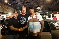 Juan van Boom walked away with the Cape Kustoms build of the 1970s MGB BT at the Cape Town Motor Show on Sunday. From left Garth Rhoda, Cape Town Motor Show, Grant Cloete from Cape Kustoms, and winner Juan van Boom. Photo credit: Maryann Shaw
