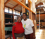 Nosheleni Ncanywa, left and her granddaughter Sikhunjulwe Ncanywa stands in the middle of their newly renovated house.