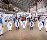 VWSA has celebrated the milestone of more than 4 million vehicles manufactured at its plant in Uitenhage. Pictured here is VWSA's Chairman and Managing Director Dr Robert Cisek (left, holding the Volkswagen logo) with production employees.