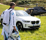 Electric mobility in new spheres: The first electrified wingsuit flight, powered by BMW i.